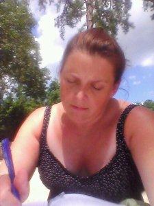 old pic of me at lake writing